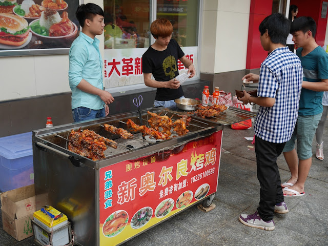 chicken cooking at a New Orleans Roast Chicken food stall