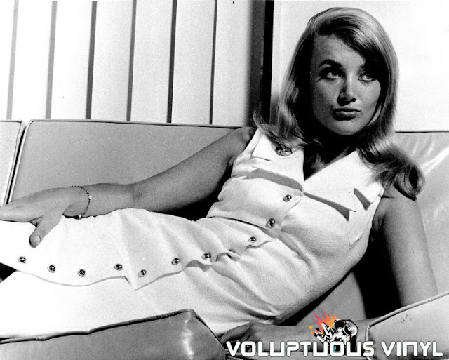 Barbara Bouchet Laying On Couch