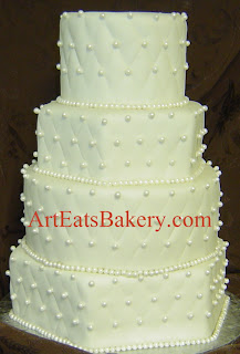 Four tier round and hexagon white diamond embossed fondant unique custom wedding cake with sugar pearls