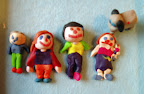 Family in Clay by Helena