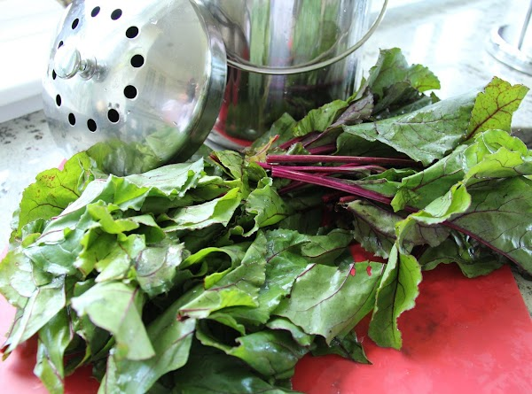 While the veggies roast away in their bright red juices, prepare the beet greens...