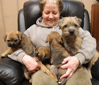 Starting to say Goodbye to the babies.9 weeks old.Becky with Indy and 3 of the pups.