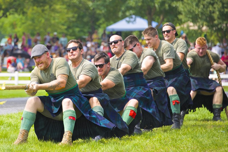 The Black Watch (Royal Highland) Regiment of Canada, pulling against the competition for the Highland Regiments tug-of-war trophy at the Glengarry Highland Games in Maxville Ontario