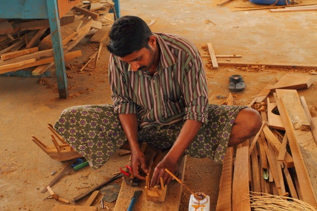 Artisans from Kerala designing ships as souvenirs at Sur, Oman