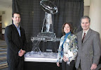 Michael, Anne and Jeff Dyson stand by an ice sculpture of the Super Bowl's Lombardi Trophy at Touchdown for Trees.