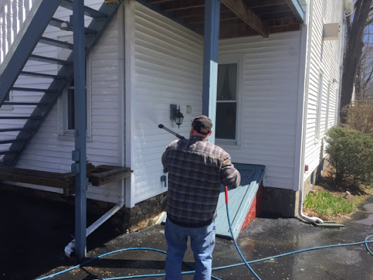 Power washing old Victorian vinyl sided house in Bethel