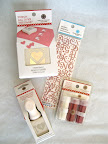 The giveaway includes these Martha Stewart Crafts punches, glitter set, and stickers!