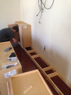 installing cabinets on cabinet base