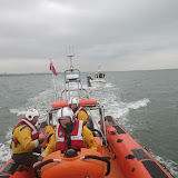 4 May 2012: The ILB tows the fishing vessel towards the harbour entrance.  Photo: Dave Riley RNLI/Poole Lifeboat