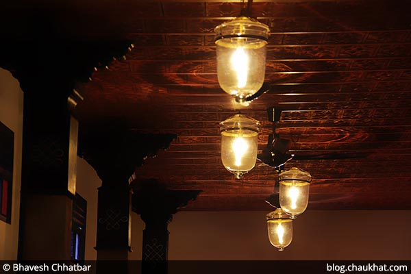 A ceiling at Savya Rasa [Koregaon Park, Pune] with special lighting on Madras roof tiles