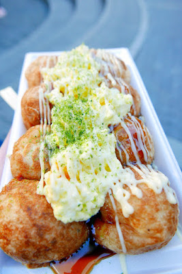 Takoyaki from takoyaki stand Ganso Donaiya in Amerikamura by Sankaku Koen with takoyaki sauce, mayo, egg and green onion