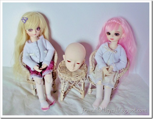 Two yosd ball jointed dolls sitting with a head.
