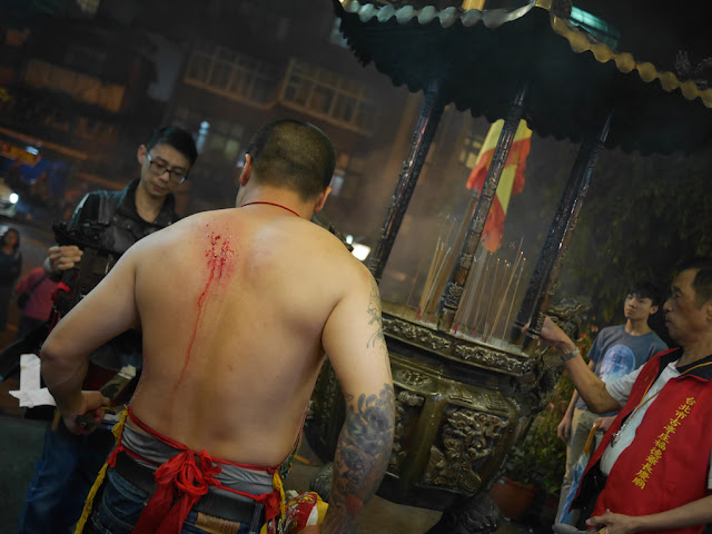 man with a bleeding back in a ceremony at the Chang Qing Temple (長慶廟) in Taipei