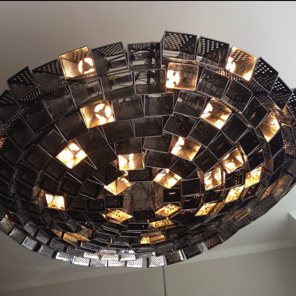 Giant cheese grater chandelier