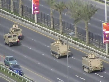 In this image from video armored personnel carriers roll towards Pearl Square occupied by anti-government protesters Wednesday, Feb. 16, 2011. Riot police firing tear gas and wielding clubs stormed a landmark square occupied by anti-government protesters before dawn Thursday, driving out demonstrators and destroying a makeshift encampment that had become the hub for demands to bring sweeping political changes to the kingdom. (AP Photo by Tony Mitchell)