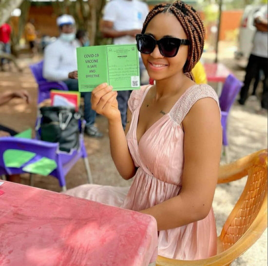 Regina Daniels shares photos showing her taking the Covid-19 vaccine