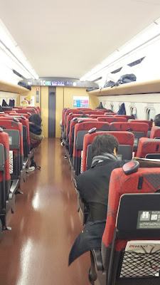 Our first shinkansen - our JR Pass lets us get free reserved seats. They all are roomy in leg room and have trays and a snack car that comes by, some of the newer ones also have plugs to charge electronic devices.