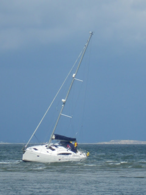 An ILB crew member had gone aboard a yacht aground on Hook Sands to check that the crew were okay and that there was no ingress of water or damage to the yacht - 27 April 2013 Photo: RNLI/Anne Millman