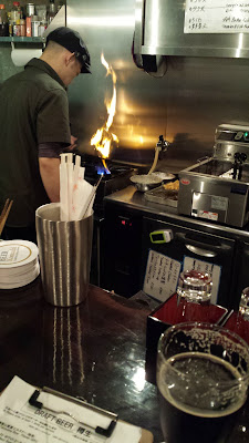 At Beer Komachi in Kyoto offering craft beer and craft food, Beer Komachi offers izakaya style food along with craft beers in Kyoto. The chef has a very small kitchen to work from of only a stove, deep fryer, oven, and toaster oven but puts out lots of options from the kitchen