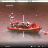 14 July - Poole ILB with crew and X boat onboard off Rockley. The crew are observing a hovercraft that was stuck on a mudbank but the ILB and crew were unable to reach it as it was high and dry. The tide was coming in so there was no immediate danger to anyone. Photo: NPAS Winfrith