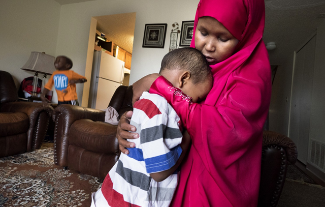 Suaado Salah comforts her 3-year-old son at their apartment in suburban Minneapolis. Luqman and his 18-month-old sister got measles during Minnesota's current outbreak, after anti-vaccine activists convinced their mother not to get the MMR vaccine. Photo: Courtney Perry / The Washington Post