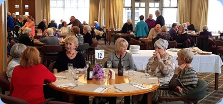 Members, residents and visitors enjoying the music.