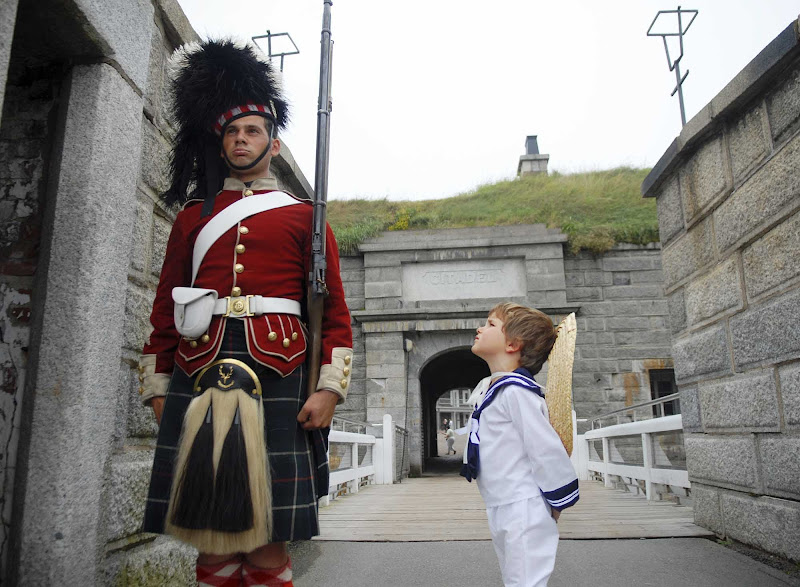 A young sailor inspects a guard at the Halifax Citadel.