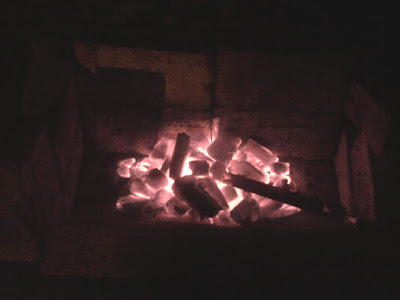 Turning the flash off on the camera, and you can see the warm glow of the forge fire