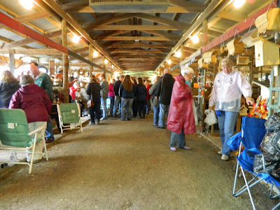 Festival-goers enjoy the variety of booths in the barn.