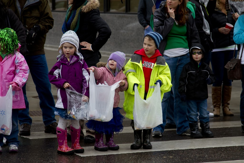Kids line up all along the street to get as much candy thrown from the floats during the parade.