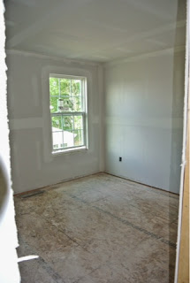 Picture of bedroom 3 as viewed from the hallway with drywall installed