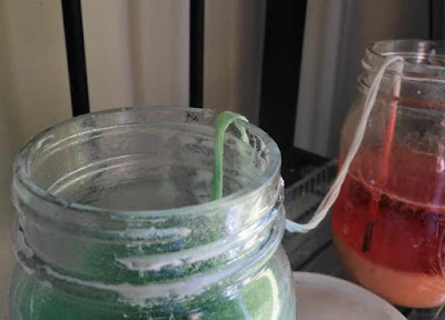 Two mason jars with a string between them as part of a science experiment.