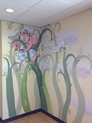 Mural done at Donna's Gourmet Cookies of flying pig serving Donna's cookies from the top of a beanstalk!