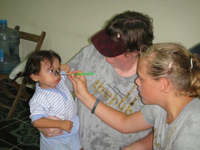Lilly and Mandy paint faces following the service.