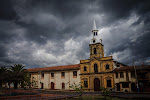 … and storm clouds loomed over the plaza. We asked around for an hospedaje and discovered some secret rooms owned by a local restaurant owner.