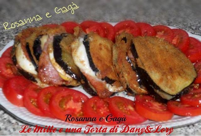 melanzane impanate e fritte, ripiene di mozzarella, prosciutto cotto e uova sode