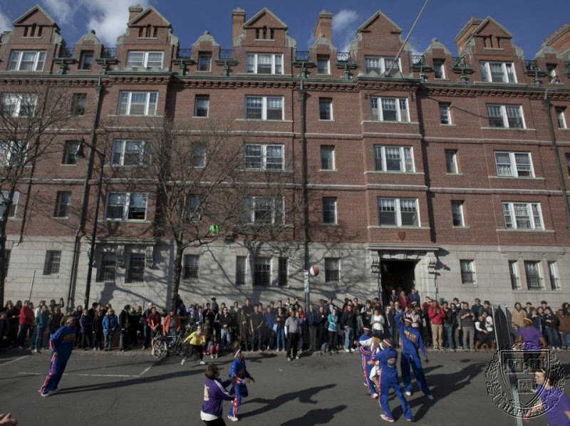 Photo: The Harlem Globe Trotters play basketball outside the Harvard Lampoon at Harvard University.   Kris Snibbe/ Harvard Staff Photographer