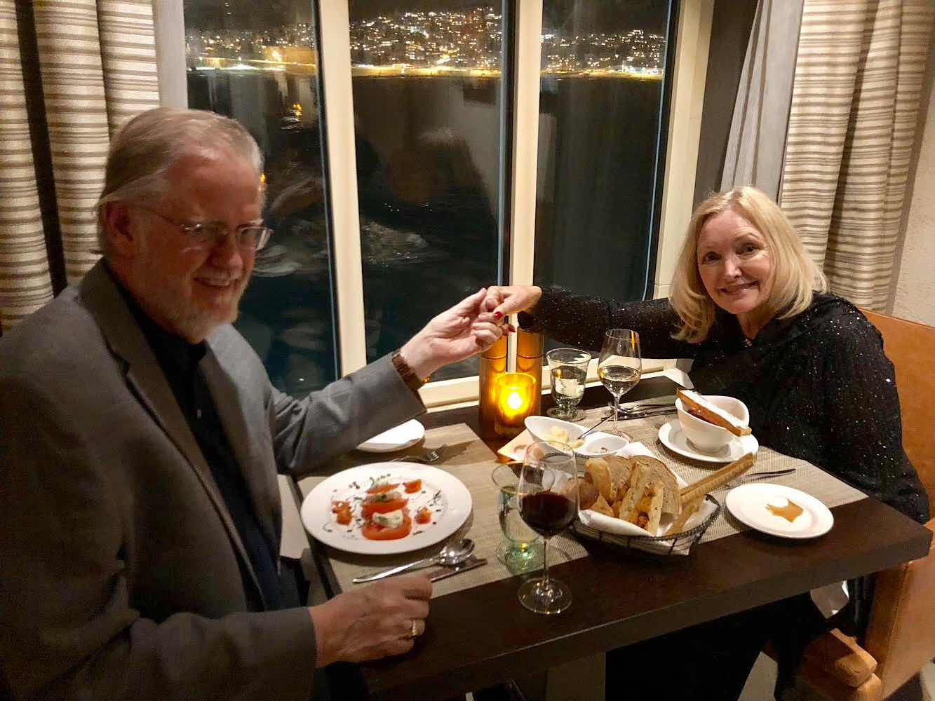 Resident Astronomers enjoy dinner with Tromsø lights in background