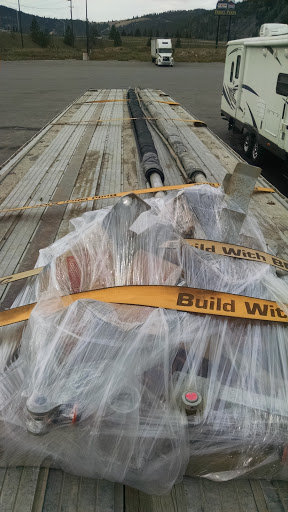 tiny load of tarps loaded on flatbed trailer