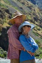 Photo: Portrait of couple taken while rafting Hell's Canyon of the Snake River, ID / OR. Hell's Canyon is the deepest canyon in North America.