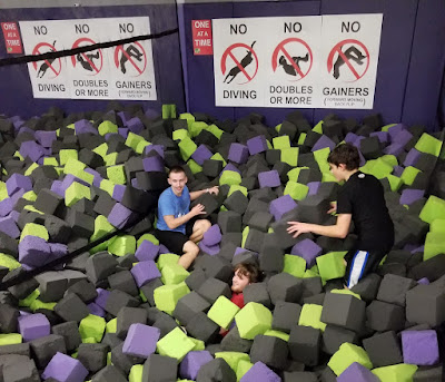 Isaiah and Chris bury Aaron in the foam pit