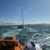 Poole ALB towing a yacht with engine and steering failure in Poole Bay on 11 May 2013. Poole ILB and Yarmouth ALB alongside. Photo: RNLI/Poole Neil Ceconi