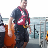 Mechanic Paul Taylor not looking very happy at having got wet! 1 September 2013 Photo: RNLI/Poole