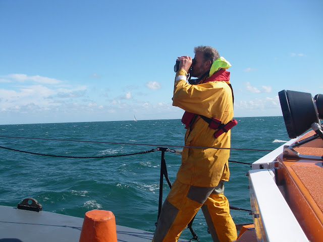 4 September 2011 - Poole Crew Member Ray Murphy searching for unaccounted people in the water during a swim between Bournemouth and Boscombe Piers. Photo: RNLI/Poole lifeboat