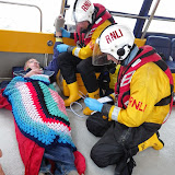 Crew Members Joe Manning and Rob Inett caring for a casualty during a training exercise - 22 April 2014 Photo: RNLI Poole/Anne Millman