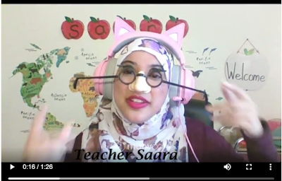 Teacher on screen with props (glasses and nose)  and a virtual background (map)