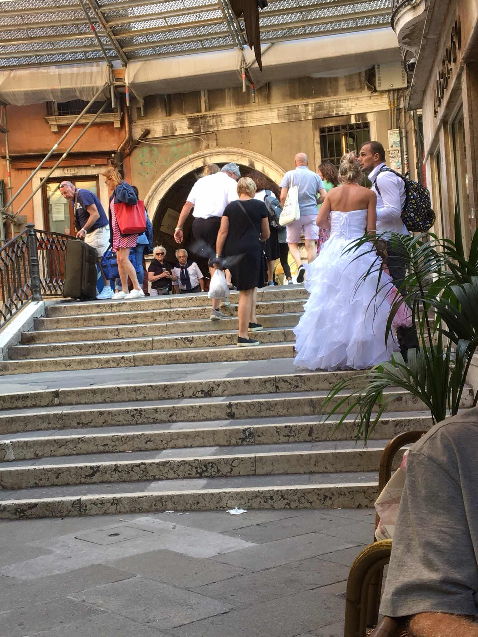 Bride and groom consulting their map in Venice.