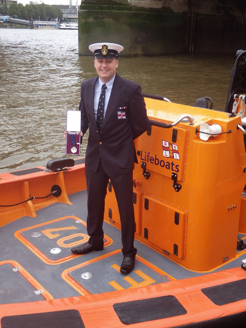 Glen Mallen with his Thomas Gray Memorial Trust Silver Medal aboard an E class lifeboat - 14 October 2014