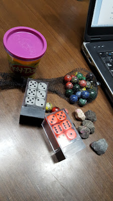 Dice, clay, rocks, and marbles.