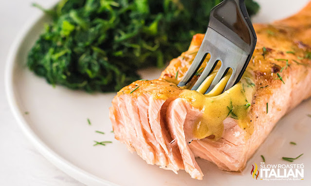 fork cutting into air fry salmon